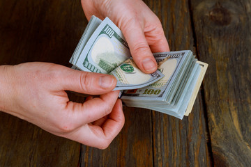 Closeup of business woman with counting money Female hands with US dollar currency cash money