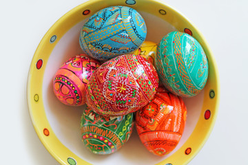Hand painted Easter eggs on a plate. Traditional Czech easter eggs.