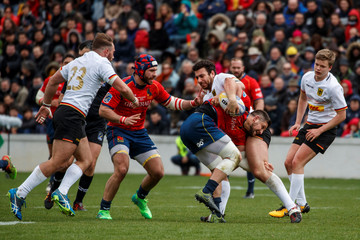 Germany's Ayachi Yassin tackles Spain's Perrin Fabien during the rugby match at Madrid University ground