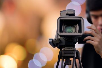 Camera Operator recording event with video camera