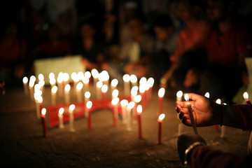 Nepali students of University of Dhaka light candles in memory of the victims of the US-Bangla aircraft crash, in Dhaka