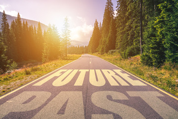 Empty asphalt road and Past and Future concept. Driving on an empty road in the mountains to the Future and leaving behind the Past. Concept for success and passing time. Wall mural