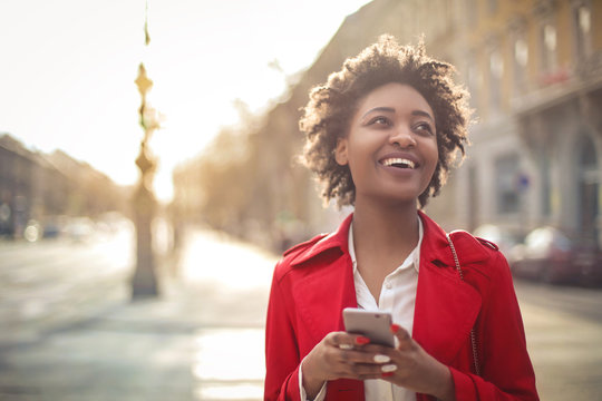 Cheerful girl laughing a lot, after checking her phone