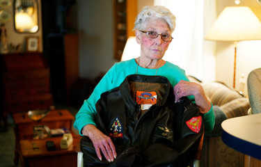 """Shirley Hollenback, wife of Gerald """"'Cactus"""" Hollenback, whose husband's ashes were lost by Sunset Mesa Funeral Directors poses with his Marine Corps bomber jacket in her home in Montrose"""