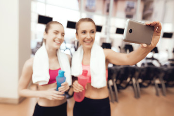 Mother and daughter taking selfie at the gym. They look happy, fashionable and fit.