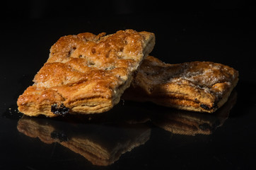 Biscuits with raisins and sugar isolated with on a black background