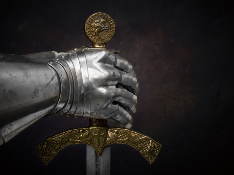 A beautiful ancient sword of the Order of the Knights Templar and an iron knight's glove.