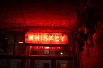 Neon whiskey bar sign
