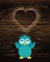 A happy owl throws a multicolored confetti in the shape of a heart