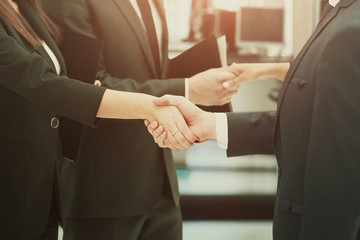 concept of cooperation.handshakes when meeting business partners