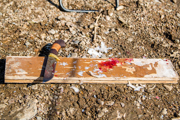 hunting knife lies on an old board for fish cleaning