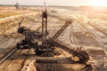 Bucket-wheel excavator mining in a open pit brown coal mine.