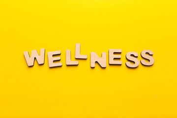 Wellness word arranged with wooden letters