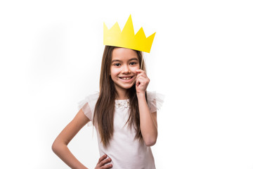 Mini Miss. Young happy girl with a cute smiling laughing wearing a crown