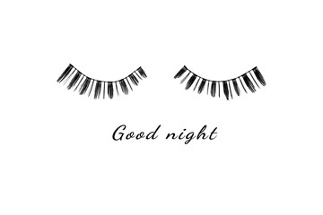 Good night with real eyelash on white background.It can be used for posters, postcards, covers, t-shirts, pillows, bags.Top view,flat lay and copy space for text.Concept sweet dream.