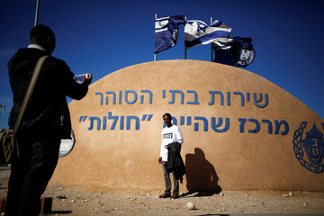 An African migrant stands for a photo outside the Holot detention centre, due to shut down on March 15, in Negev desert