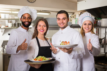 waitress and cooking team at kitchen