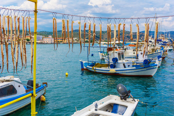 Octapuses hangind under the sun in order to dry at the harbor of Gythio in Peloponnese Greece