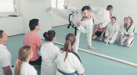 Karate coach teaching adults