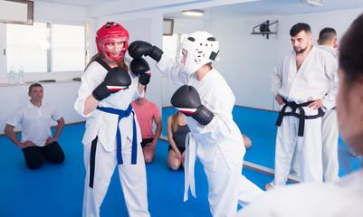 Girls demonstrate their martial arts skills