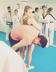 Girl learn how to use self-defense techniques