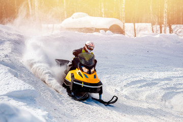 Snowmobile. Snowmobile races in snow. Concept winter sports, racers.
