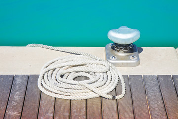 Cleat for mooring boats on wooden platform