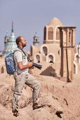 Solo traveler walks through the ancient town of Kashan , Iran.