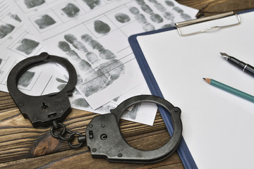 police report, handcuffs, fingerprints. Detective, officer. capture of the attacker, description of the incident. The forensic scientist