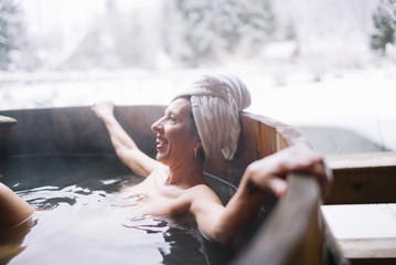 Cheerful topless woman in plunge tub