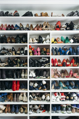 Shelves with different shoes