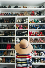 Person in front of shelves with different shoes