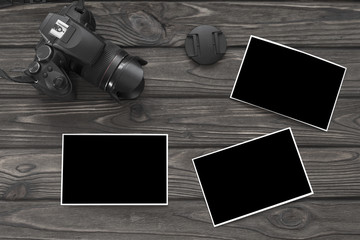 camera, photo paper on the background of a wooden table. The Art of Photography