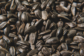 Black sunflower seeds background. Healthy food. Macro photo.