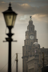 Sun breaks through the clouds above the Liver Building in Liverpool, England.