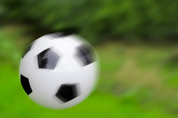 Soccer ball on a green background, soft focus