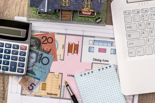 Laptop With House Plan Australian Dollar Pen And Calculator