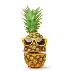 Juicy pineapple in sunglasses, cut into parts on a white background. Summer mood. Isolated.