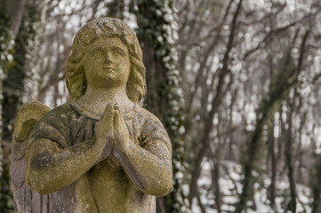 Old stone angel praying (religion, Christianity, faith concept)