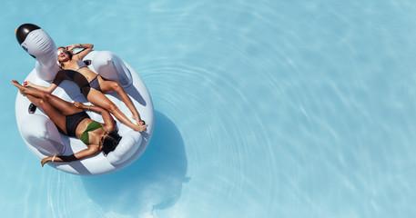 Woman sunbathing on floating pool inflatable toy