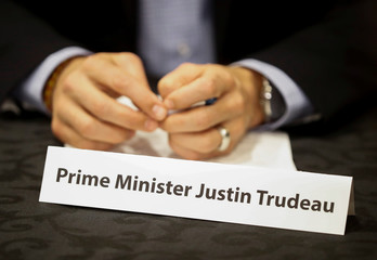 Canada's PM Trudeau sits behind his name card at a round table discussion with steel industry leaders in Hamilton