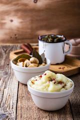 Healthy vegetarian meal. Mashed potatoes,  pickled mushrooms, sea kale salad on rustic table