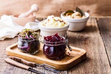 Healthy vegetarian meal. Mashed potatoes,  pickled mushrooms, sea kale salad and beetroot salad on rustic table