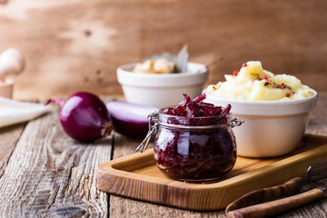 Healthy vegetarian meal. Mashed potatoes,  pickled mushrooms,  and beetroot salad on rustic table