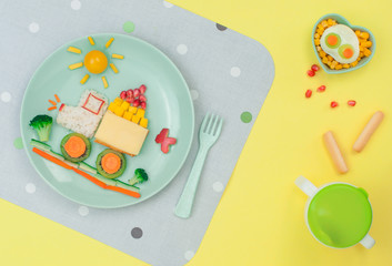 Car from rice, sandwich and fresh fruits and vegetables on the yellow background