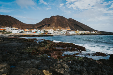 Fotobehang Zuid Afrika Calhau village on ocean coast in front of red colored volcanic crater. Cape Verde - Sao Vicente Island