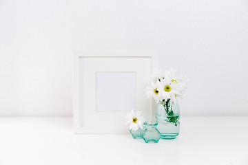 Composition with glowers and frame. Mock up creative minimal background