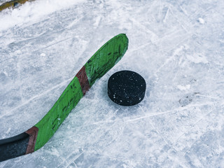 hockey puck and stick on the ice texture, copyspace and text