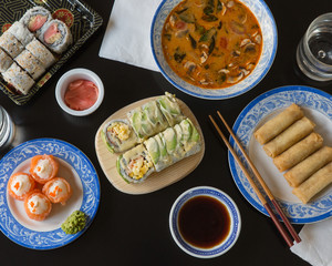 Soup, spring rolls, and sushi rolls