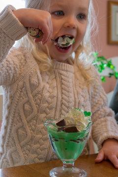 Little girl eating homemade shamrock shake ice cream sundae